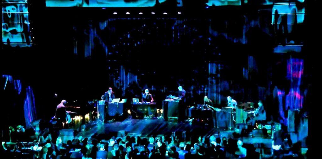 "John Tilbury, Erik Honoré, David Sylvian, Jan Bang, Eivind Aarset, Philip Jeck, Arve Henriksen under Konserten ""Plight & Premonition"" Punkt 2011. Foto: Punkt Festivalen."